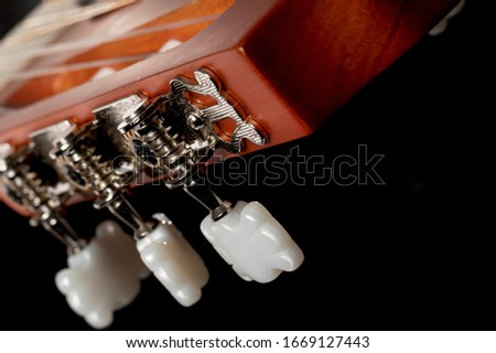 A macro shot of acustic guitar machine heads used for tuning strings stock photo