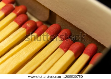 A macro shot of matches in a box with shallow depth of field #1205530750