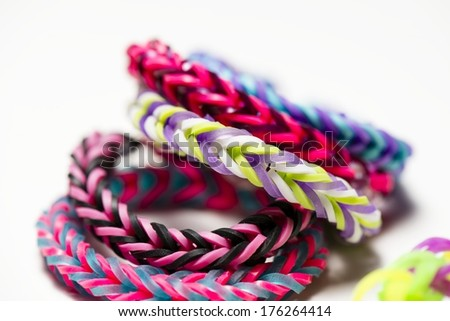 a macro shot of rubber band bracelets. - stock photo
