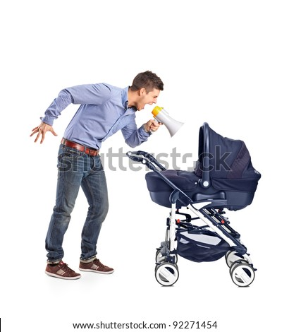 A mad father yelling to his baby laid down in a baby carriage isolated on white background