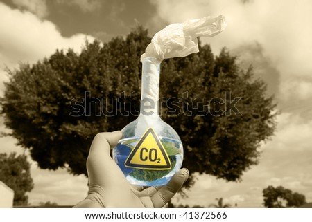 a Mad Scientist holds a 500ml beaker filled with CO2 with a paper wick as a Molotov cocktail against the sky, representing  A Global Warming Time Bomb, in monocrome and colorized