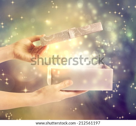 A magical glowing present box being opened