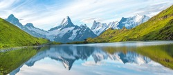 A magical panorama landscape with a lake in the mountains in the Swiss Alps, Europe. Wetterhorn, Schreckhorn, Finsteraarhorn et Bachsee. ( relaxation, harmony, anti-stress - concept).