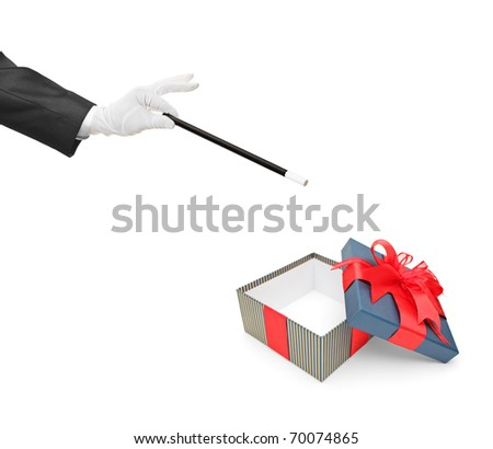 A magician holding a magic wand over an empty gift box isolated on white background