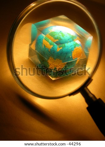 "A magnifyer and the globe (encased in a plexiglass ""ozone layer"")."