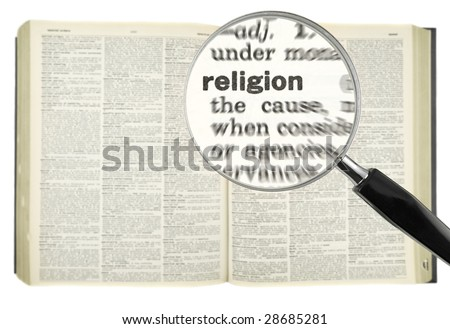 A magnifying glass on the word RELIGION on a dictionary.