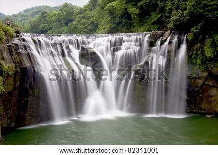 a majestically beautiful waterfall in Taiwan - stock photo