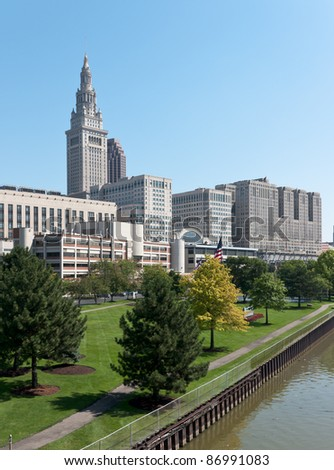 A major Cleveland, Ohio corporation's well manicured employee recreation area on the bank of the Cuyahoga River with the Terminal Tower and a portion of the Tower City complex in the background