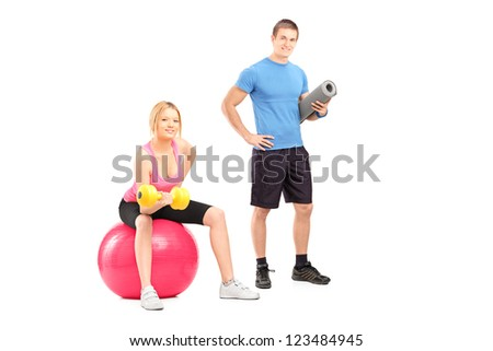 A male and female athletes with equipment posing isolated on white background