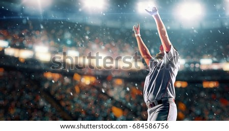 A male baseball player is happy after winning a match. He wears unbranded sport clothes. The stadium is made in 3D.