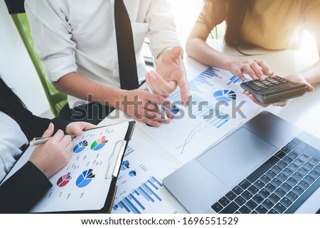 A male business consultant describes a marketing plan to set business strategies for women business owners with using calculator. business planning and  researching concept.