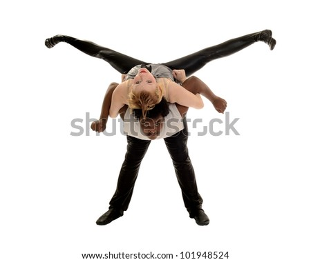 A male dancer lifts a female in jazz dance performance costume