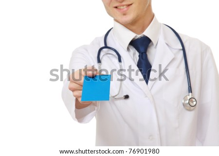 A male doctor giving a blank card