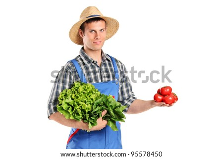 A male farmer holding vegetables isolated on white background