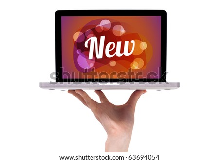 a male hand holding a laptop with abstract NEW sign, isolated on white - stock photo
