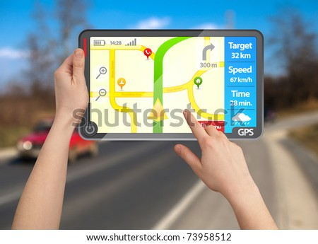 a male hand holding a modern colorful touchpad gps tablet