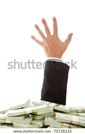 A male hand stretching out of money heap