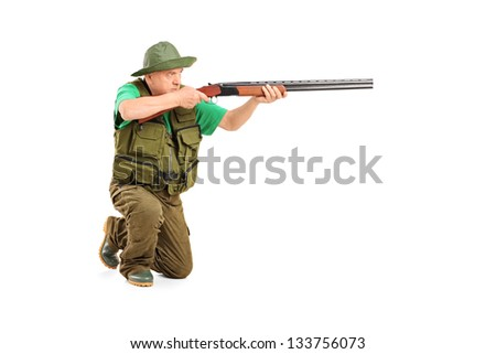 A male hunter shooting with a rifle isolated on white background