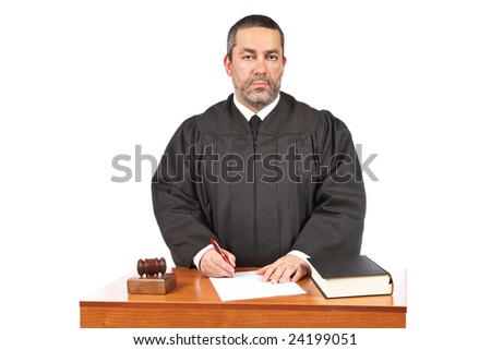 A male judge in a courtroom sign to blank court order