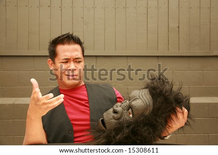 a male model makes a face at the request of the photographer to wear his Gorilla Costume Head