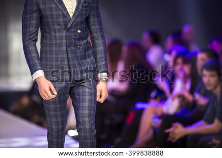 A male model walks the runway during the 2016 Sofia Fashion Week Show in Sofia, Bulgaria.