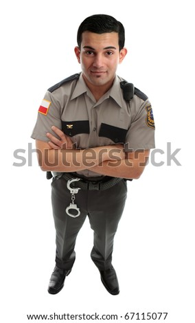 A male prison guard warden or policeman in uniform with duty belt and radio unit.   Standing with arms crossed and looking up.  White background