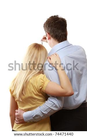 A male realtor giving keys to a woman