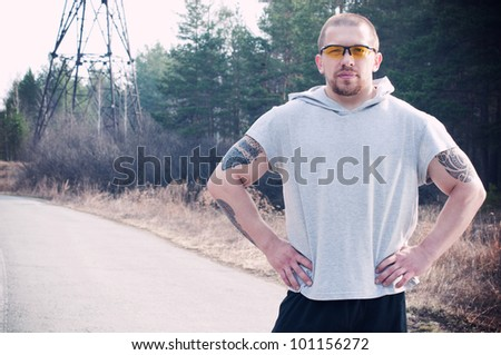 A male runner envisions his pace before the run