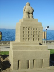 A male's sculpture made of sand during a sculpture festival