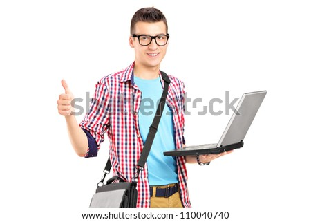 A male student working on a laptop and giving thumb up isolated on white background