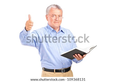 A male teacher holding a book and giving a thumb up isolated on white background