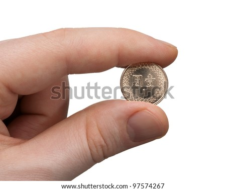 A male thumb and index finger gripping a New Taiwan 1 Dollar Coin.