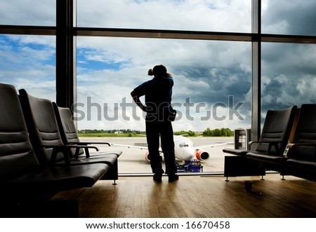 A male waiting sleeping in the airport