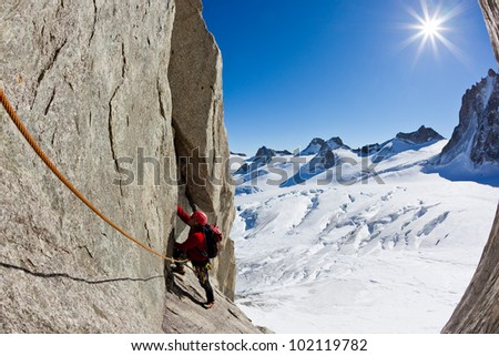 A male young climber along a pitch on the south face of Mont Blanc massif. Petit Capucin, Mont Blanc, France.