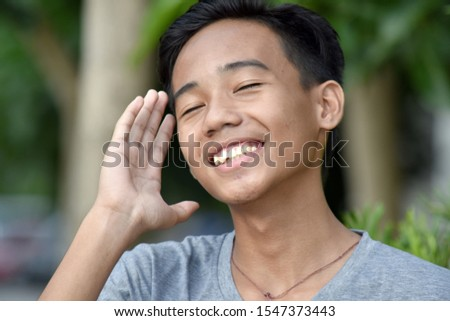 A Male Youngster And Laughter #1547373443