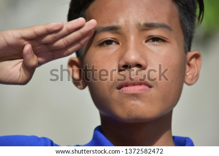 A Male Youngster Saluting