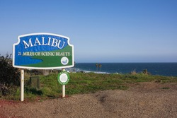 A Malibu sign with the ocean in the background