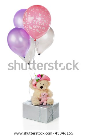 "A mama and baby bear on a silver-wrapped gift holding colorful balloons, one of which says, ""It's a girl"".  Isolated on white."