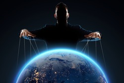 A man, a puppeteer, manipulates the planet. The concept of world conspiracy, world government, manipulation, world control