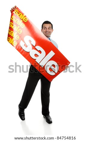 A man about to hang up a large Sale banner sign.  Suitable for many uses, retail, Christmas,clearance, etc.  Focus to the sign.
