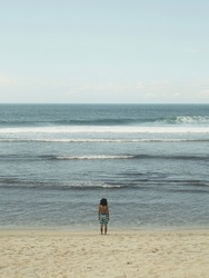 A man alone in front of the sea in Pacitan