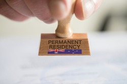 A man and a stamp for a visa to Australia