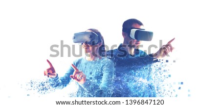 A man and a woman in glasses of virtual reality. The concept of modern technologies and technologies of the future. Fragmented by pixels. VR glasses. #1396847120