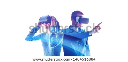 A man and a woman in glasses of virtual reality. The concept of modern technologies and technologies of the future. VR glasses. #1404516884