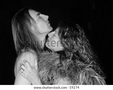 stock photo : A man and a woman totally in love embrace. Sexy kiss on
