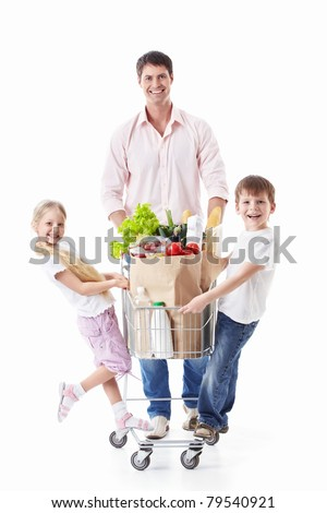 A man and two children with a cart with food on a white background