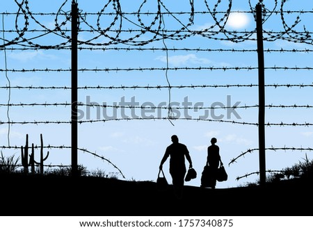 A man and woman are seen in silhouette after breaching a border fence on the southern border of the USA. They have gone through a broken barbed wire fence.  Foto stock ©