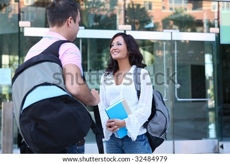 A man and woman at college talking outside class