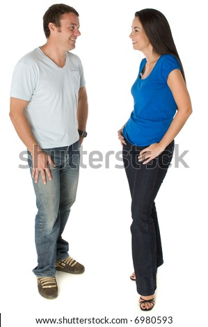 A man and woman standing together talking on white background