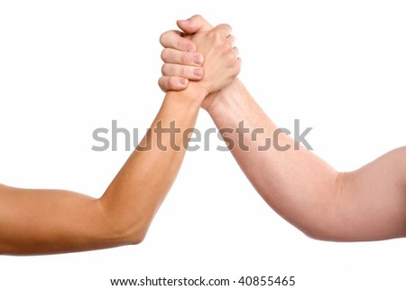A man and woman with hands clasped arm wrestling.